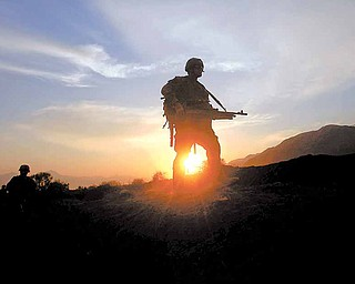 U.S soldiers of  2nd Platoon Bravo Company 2-327 patrols as sunset  in Chowkay district of Kunar province in eastern Afghanistan near Pakistan border on Sunday, Dec 26, 2010.