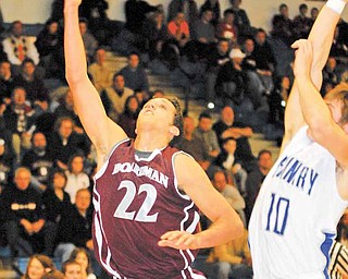 Boardman's #22 Dave DeBernardi puts a shot up while Poland's #10 Colin Reardon goes for the swat.