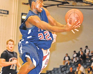 Fitch's #22 Dontrell Lawrence puts up an off balance shot during the second half.