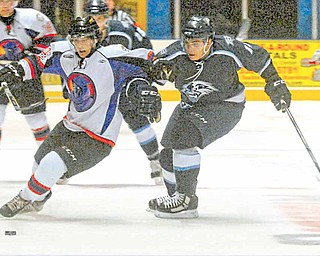 Mike Ambrosia of the Phantoms races Jarrod Rabey of the Indiana Ice to the puck.