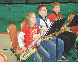 Banding together: The school band at St. Patrick School in Hubbard performed a concert for other students, family members and friends on Dec. 21 at the parish center. Laura Volenik, band director, conducted the students as they presented a program of holiday classics. A segment of the concert featured a saxophone performance by several students, including, from left, Mary Lyons, Tim Wirtz and Josh Chrobak. The band is open to students in grades four through eight and presents several program throughout the year.