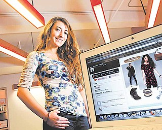 Carla Larin, pictured December 15, 2010, is an intern from Bergen Academy working at PlumWillow, a fashion themed social shopping community on the Internet.