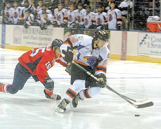 Phantom Mike Ambrosia moves in to score Wednesday night. He was defended by Andrew Miller of the Des Moines Buccaneers.
