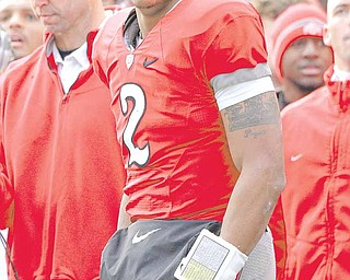 Ohio State  quarterback Terrelle Pryor (2) watches from the sidelines during second quarter action in their NCAA college football game against Michigan on Saturday, Nov. 27, 2010, in Columbus, Ohio.
