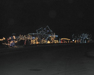 John and Dee Deem, whose holiday decorations span two lots, say people who drive by their Struthers home often stop and compliment their display.