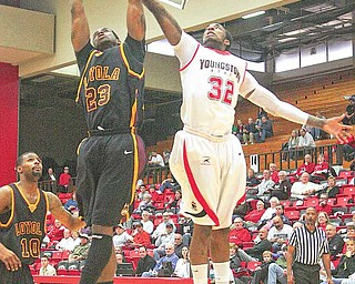 YSU's Tre Brewer fights with (23) Geoff McCammon for the ball during a game in January 2011. After appearing in all but one of YSU's games this winter, Brewer decided to transfer to Cal State San Bernardino, a Division II school.