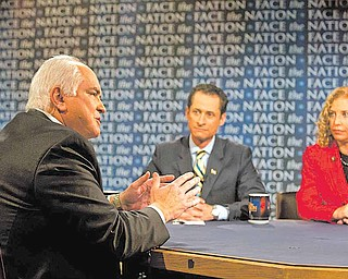 """In this photo provided by CBS, Rep.-elect Mike Kelly, R-Pa., left, and representatives Anthony Weiner, D-N.Y., and Debbie Wasserman Schultz, D-Fla., discuss what's ahead for the new Congress on CBS's """"Face the Nation"""" in Washington Sunday, Jan. 2, 2011."""