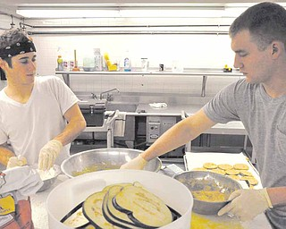 Members of Ohio Valley Teen Challenge work in the kitchen of the rehabilitation center in Youngstown. Thanks to an outpouring of donations, the program's kitchen and catering service has been expanded.