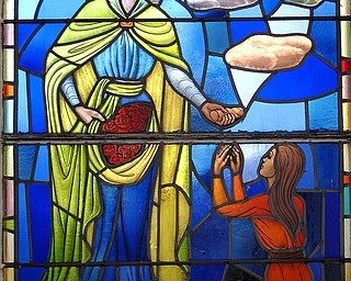 A stained-glass window at St. Elizabeth's Church in Campbell. The church held its final mass at 9 a.m. Sunday.