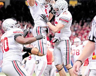 Ohio State wide receiver Dane Sanzenbacher (12) celebrates his touchdown with running back Dan Herron (1) in the second quarter of the Sugar Bowl NCAA college football game against Arkansas at the Louisiana Superdome in New Orleans, Tuesday, Jan. 4, 2011.