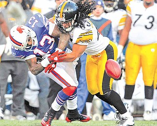 In this Nov. 28, 2010, file photo, Pittsburgh Steelers'  defender Troy Polamalu (43) breaks up a pass intended for Buffalo Bills' wide receiver Steve Johnson (13) during the second half of an NFL football game in Orchard Park, N.Y. The Steelers were reminded again what they were missing when Polamalu was injured for most of the season. Against Buffalo, his instinctive play preserved their chances of winning their division.