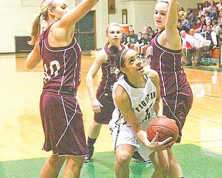 Villida Whitehead (14) drives to the hoop as Kayleigh Lipke (40), Jenna Kuczek (33) and Brooke Meenachan  (21) play defense during their game Wednesday night in Youngstown.