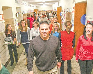Michael Kerensky, Canfield Village Middle School teacher and supporter of the Race to the Top initiative, walks the hallways with students as he helps ready the school, teachers and administrators for the new program.