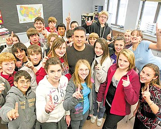 Michael Kerensky, Canfield Village Middle School teacher, stands with his seventh grade history class. The Race to the Top grant will help the school improve even with its Excellent rating from the Ohio Department of Education.