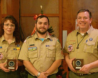 In recognition of their noteworthy service to area youth through Scouting and service to the community, Jill Blance, at left, and Cliff Hovis, at right, were the recipients of the District Award of Merit for 2010, the highest award a district Scout leader can receive. They were joined by Chief Kiondashawa District Executive Brad Parola after accepting their awards.