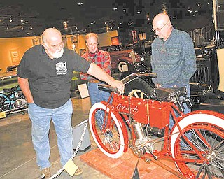 "Bruce Williams of Cortland, left, talks about the 1908 Crouch motorcycle with Randy Kretz of Newbury, Ohio, center, and John Snodgrass of Farmington. Williams is co-chairman of the ""Motorcycles on Main Street Exhibit at the Packard Museum in Warren."