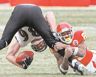 Kansas City Chiefs safety Eric Berry tackles Baltimore Ravens tight end Todd Heap during the first quarter of an NFL AFC wild card football playoff game Sunday, Jan. 9, 2011, in Kansas City, Mo.