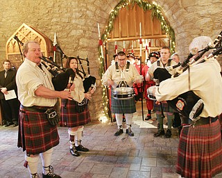 Traditional costumes are part of the annual Boar's Head and Yule Log Festival at St. John's Episcopal Church in Youngstown, which marked its 50th year Sunday. The festival is a liturgical drama featuring the traditions of early Christianity and of the Medieval and Renaissance periods.