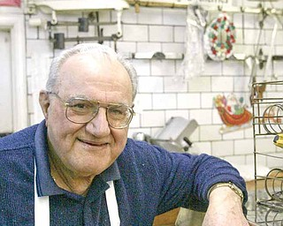 Joe Cherol near the meat counter in his store.