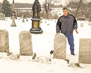 Tim Monroe, road and cemetery superintendent in Liberty Township, stands in Church Hill Cemetery at state Route 304 and Belmont Avenue. Cemetery maintenance is one of the mandated duties of township trustees..
