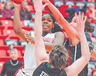 YSU Penguin Brandi Brown shoots and scores while being defended by Green Bay's Sarah Eichler(43) and Julie Wojta (32).