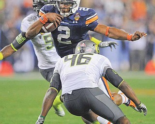 Auburn's Cam Newtown runs with the ball as Oregon's Michael Clay (46) moves in during the second half of the BCS National Championship NCAA college football game Monday, Jan. 10, 2011, in Glendale, Ariz.