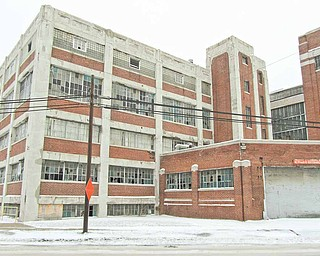 The broken windows of Delphi Packard Electric Plant 8 at Griswold Street and Paige Avenue in Warren. The city has issued a demolition order for this and two other former Delphi plants.