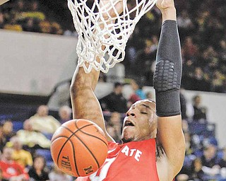 Ohio State forward Jared Sullinger (0) dunks during the first half of an NCAA college basketball game against Michigan in Ann Arbor, Mich, Wednesday, Jan. 12, 2011. (AP Photo/Carlos Osorio)
