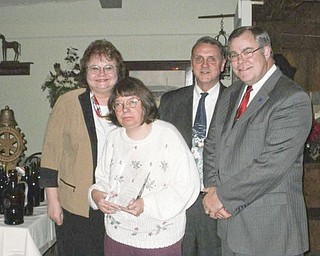 Sharing one of the special moments during an annual Mercer Rotary Club holiday party were, from left, Grace Anna Boggs, club vice president; Gail Habbyshaw, who was the recipient of the Dr. Bernard Hoyt Community Service Award; Walt Johnson, secretary; and Tom Jones, past president.