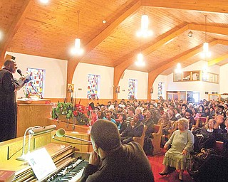 Bishop Durant K. Harvin III preached to a full congregation at a community service at Tabernacle Baptist Church on Arlington Avenue on the North Side on Sunday. It was a commemoration of the life of the Rev. Dr. Martin Luther King Jr. Harvin, of Baltimore, was once pastor of a Youngstown church.