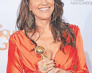 """Katey Sagal holds up her award that she won for Best Performance by an Actress in a Television Series - Drama for her role in """"Sons of Anarchy,"""" at the Golden Globe Awards Sunday, Jan. 16, 2011, in Beverly Hills, Calif."""