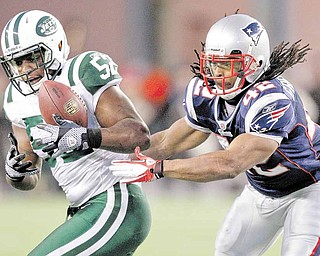New York Jets linebacker David Harris (52) makes an interception in front of New England Patriots running back BenJarvus Green-Ellis (42) on a pass thrown by Tom Brady during the first half of an NFL divisional playoff football game in Foxborough, Mass., Sunday, Jan. 16, 2011.