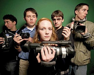 """Shorecrest High School students Jesse Hoefer, left, Nicholi Wytovicz, Mara Harris, Samuel Chudler and Corey Smith are video documenting """"The Social Experiment,"""" a project where hundreds of Shoreline high-school students are giving up social media for one week."""