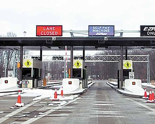 Problems at this automated toll booth at the Ohio Turnpike exit near the General Motors complex in Lordstown have some employees taking a different route to and from work at the plant. The lane at which a toll collector had been stationed was closed.