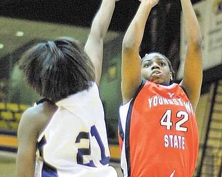 KSU's Taylor Stanton tries to block a shot by YSU's Brandi Brown during the first period on Wednesday night at the Kent State MAC center in Kent, Ohio.