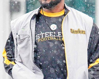 Pittsburgh Steelers coach Mike Tomlin walks to an indoor practice field for the NFL team's practice in Pittsburgh, Tuesday, Jan. 11, 2011. The Steelers host the Baltimore Ravens Saturday Jan. 15 in a divisional playoff game.