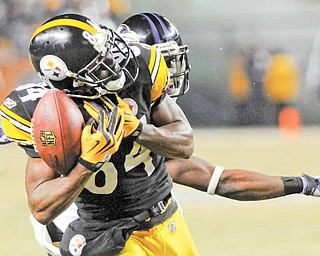 In this Jan. 15, 2011, file photo, Pittsburgh Steelers wide receiver Antonio Brown (84) beats Baltimore Ravens cornerback Lardarius Webb on a long pass during the second half of an NFL divisional playoff football game in Pittsburgh. The play set up Rashard Mendenhall's touchdown to give the Steelers the 31-24 win. Three catches and 75 yards later, the Central Florida product is drawing national attention.