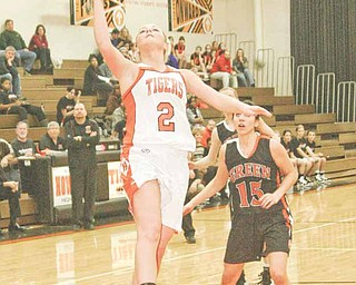 Howland's Olivia Nicholas (2) drives to the hoop Wednesday night in Howland, as Green's Lydia Covle (15) looks on.