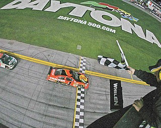 In this Feb. 14, 2010, file photo, Jamie McMurray (1) followed by Dale Earnhardt Jr. (88) crosses the finish line to win the the NASCAR Daytona 500 auto race at Daytona International Speedway in Daytona Beach, Fla. McMurray won at NASCAR's three most prominent tracks last season, including the Daytona 500. He didn't make the Chase for the Sprint Cup championship. That wouldn't be the case under a proposed format, a hot-button issues as drivers prepare for next month's Super Bowl of stock car racing.