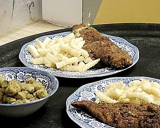 Fried fish, french fries and fried okra are among the menu items at Youngstown Soul Food.