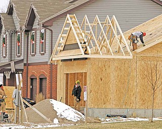 In this Jan. 10, 2011 photo, a new home is under construction, in Monroe, Ohio. U.S. homebuilders remain discouraged over the prospects for improved home sales in the months ahead, unconvinced as yet that the economy will spur the kind of job growth needed to coax more buyers into the market.