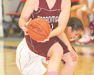Boardman's Brooke Meenachan (22) gets tangled up with Mariah Snowden of Fitch during a game Thursday at Fitch High School in Austintown. The Spartans defeated the Falcons, 57-54.
