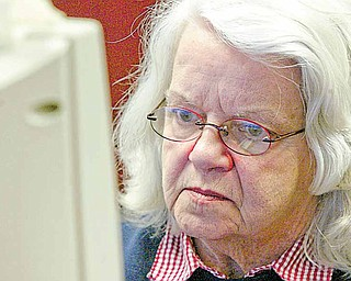 Penny Gunter concentrates in a computer class at Hubbard Public Library. The Hubbard resident is taking the free instruction so she can use e-mail to communicate with a sister in Denver and access the library's card catalog from her home.