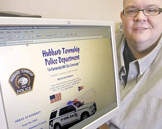 """""""Beezer"""" Matkovich, website administrator for Hubbard Township Police Department, shows the home page of the site, www.hubbardtwppd.org. Matkovich said the site offers straight-forward information to help people in many situations."""