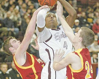 Boardman's T.J. Irving goes towards the hoop as Mooney's P.J.Quin, left, and  Danny Reese defend during 1 rst half action at Boardman.