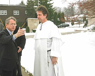 Ohio Attorney General Mike DeWine, left, met with the Rev. Greg Maturi at St. Dominic Church, 77 E. Lucius Ave., to discuss the crime problem in Youngstown. The attorney general was here Tuesday and said the process of reducing the city's crime rate was ongoing.