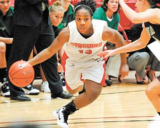 Closely guarded by Green Bay's Celeste Hoewisch, YSU's Macey Nortey drives to the basket. .