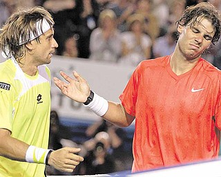 Spain's Rafael Nadal, right, reacts as he talks with compatriot David Ferrer at the net after his quarterfinal loss to Ferrer at the Australian Open tennis championships in Melbourne, Australia, Wednesday, Jan. 26, 2011.