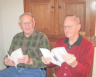 """Members of the Niles Historical Society view the city's """"Nickname"""" books as they work on the next printing. George John, left, and Frank Burke are on the committee preparing for the third installment of books that contain hundreds of informal tags that identify hundreds of Niles residents."""