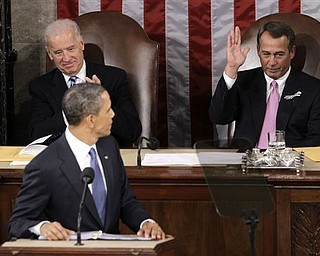 House Speaker John Boehner gestures after being acknowledged by President Barack Obama during his State of the Union address in Washington, Tuesday, Jan. 25, 2011. Vice President Joe Biden is at left.  (AP Photo/Charles Dharapak)